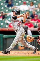 Brennan Moore #21 of the Texas Tech Red Raiders follows through on his swing against the Arkansas Razorbacks at Minute Maid Park on March 2, 2012 in Houston, Texas.  The Razorbacks defeated the Red Raiders 3-1. (Brian Westerholt/Four Seam Images)