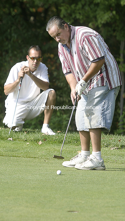 PLYMOUTH, CT -04 OCTOBER 2007 --100407DA04-  Paul Lemaire of Terriville putts as David Piotrowski of Terriville looks on at the Pequabuck Golf Club of Bristol Thursday. The Polish American Political Club sponsored its second annual golf tournament to raise money for Toys for Tots for Tots.<br /> Darlene Douty/Republican-American