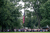 A crowd gathers before Cindy McCain, wife of, Sen. John McCain, R-Ariz., arrives to lay a wreath at the Vietnam Veterans Memorial in Washington, Saturday, Sept. 1, 2018, during a funeral procession to carry the casket of her husband from the U.S. Capitol to National Cathedral for a memorial service. McCain served as a Navy pilot during the Vietnam War and was a prisoner of war for more than five years.<br /> Credit: Andrew Harnik / Pool via CNP
