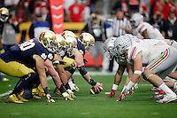 Notre Dame Fighting Irish offensive takes on the Ohio State Buckeyes defense in the third quarter during the Fiesta Bowl in the University of Phoenix Stadium on January 1, 2016.  (Dispatch photo by Kyle Robertson)