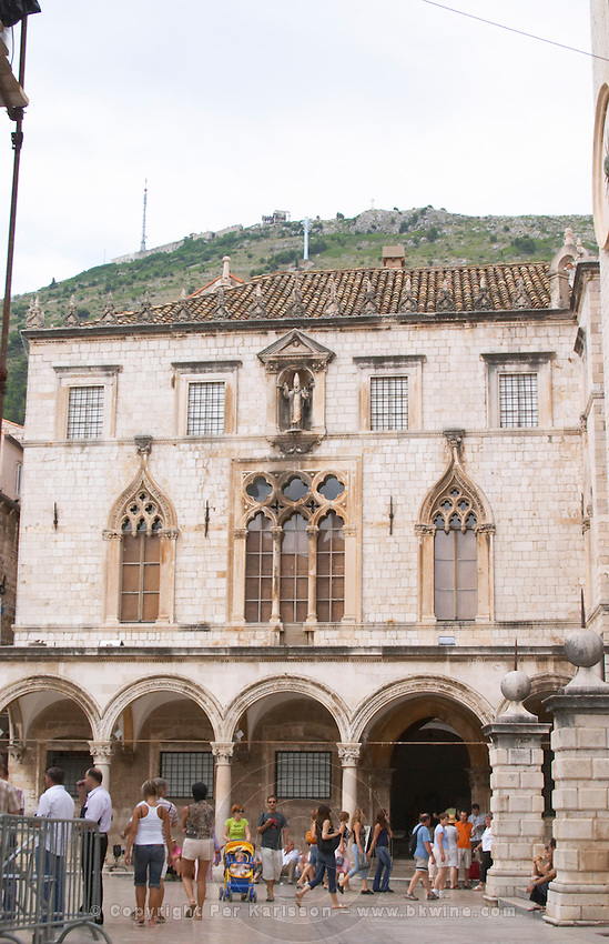the arched porch and facade in front of the Sponza palace on the Luza Lodge Loggia Square on the Pred Dvorom street Dubrovnik, old city. Dalmatian Coast, Croatia, Europe.