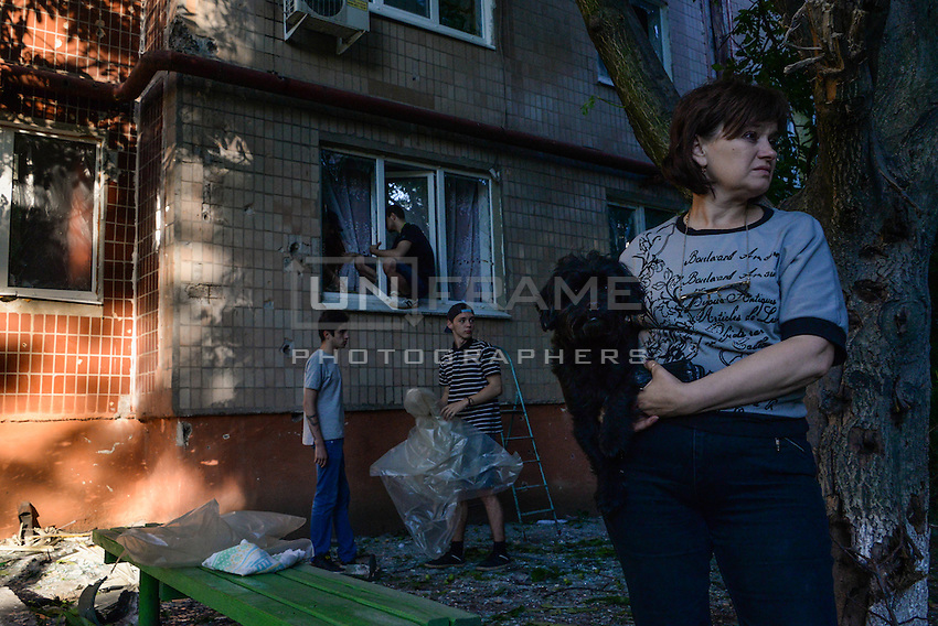 Citizens of Slavyansk try to repair their home struck by shelling. Slovyansk, Ukraine.