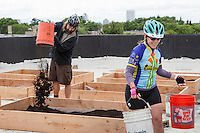 "bonus checkpoint at the Martin Luther King Community Center, ""Bucket Brigade"" where riders took buckets of dirt to fill a new rooftop garden project"