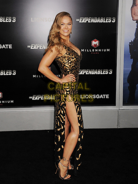HOLLYWOOD, CA- AUGUST 11: Actress Ronda Rousey arrives at the Los Angeles premiere of 'The Expendables 3' at TCL Chinese Theatre on August 11, 2014 in Hollywood, California.<br /> CAP/ROT/TM<br /> &copy;Tony Michaels/Roth Stock/Capital Pictures