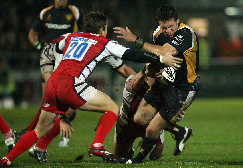 Photo: Rich Eaton...Worcester Warriors v Gloucester Rugby. Guinness Premiership. 13/10/2006. Thomas Lombard right of Worcester is tackled by Rory Lawson of Gloucester
