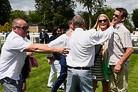 Connections of Initiative celebrate in the winners enclosure after winning The Bathwick Tyres Novice Auction Stakes(plus 10, Div 1), during Afternoon Racing at Salisbury Racecourse on 13th June 2017