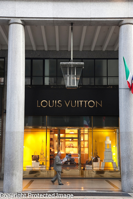 Louis Vuitton Shop in Via Roma Street with business man walking past in Turin - Torino, Italy