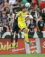 Andy Najar #14 of D.C. United loses a header to Gino Padula #4 of the Columbus Crew during an MLS match at RFK Stadium on September 4 2010, in Washington DC. Columbus won 1-0.
