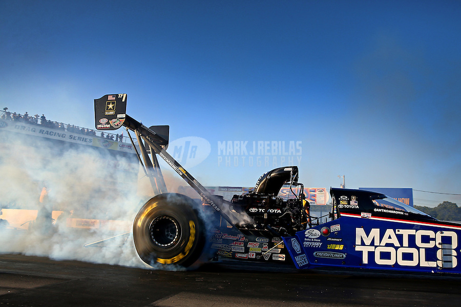 Aug. 16, 2013; Brainerd, MN, USA: NHRA top fuel dragster driver Antron Brown during qualifying for the Lucas Oil Nationals at Brainerd International Raceway. Mandatory Credit: Mark J. Rebilas-