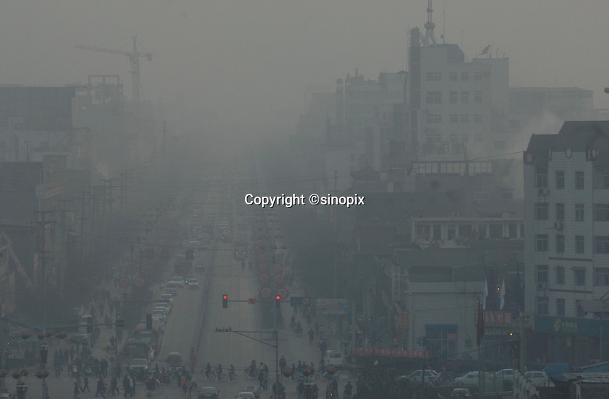 The city centre Linfen City is shrouded in pollution at 11.30 am on a sunny day, Shanxi Province, China. Linfen has been identified as one of the most polluted cities in China..30 Jan 2007