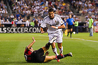 Daniele Bonera (25) of A. C. Milan trips m7\ of Real Madrid. Real Madrid defeated A. C. Milan 5-1 during a 2012 Herbalife World Football Challenge match at Yankee Stadium in New York, NY, on August 8, 2012.