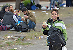 A refugee child holds a sandwich at the border crossing into Austria near the Hungarian town of Hegyeshalom. Hundreds of thousands of refugees and migrants--including many children--flowed through Hungary in 2015, on their way to western Europe from Syria, Iraq and other countries. The ACT Alliance has provided critical support for refugee and migrant families here and in other places along their journey--including the sandwich.