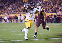 C.J. Anderson of California runs for a touchdown during a game against Arizona State at Sun Devil Stadium in Tempe, California on November 25th, 2011  - California defeated Arizona State  47 - 38