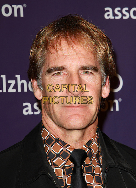 "SCOTT BAKULA .19th Annual ""A Night at Sardi's"" Benefiting the Alzheimer's Association held at the Beverly Hilton Hotel, Beverly Hills, California, USA, 16th March 2011..portrait headshot  suit black tie brown print shirt .CAP/ADM/KB.©Kevan Brooks/AdMedia/Capital Pictures."