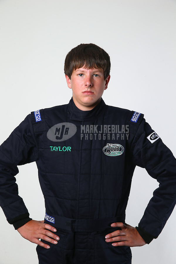 Mar. 21, 2014; Chandler, AZ, USA; LOORRS modified kart driver Taylor Wood poses for a portrait prior to round one at Wild Horse Motorsports Park. Mandatory Credit: Mark J. Rebilas-USA TODAY Sports
