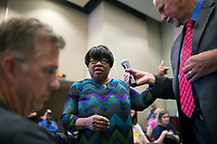 NWA Democrat-Gazette/CHARLIE KAIJO Moderator Jon Comstock (right) holds a mic for Sheree Miller of Bentonville while she shares her opinion about the Confederate statue in Bentonville Square at the Walmart Auditorium in the Shewmaker Center for Workforce Technologies, NWACC Campus in Bentonville, AR on Saturday, September 9, 2017. Community members discussed opinions on the Confederate soldier statue in the Bentonville Square and what should be done about it.
