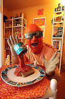 Pictured: Captain Beany in his museum.<br /> Re: Captain Beany (aka Barry Kirk) founder of the first Bean Museum of Excellence in a council flat in Port Talbot, south Wales.<br /> Caped crusader Captain Beaney has converted his welsh flat home into a historical tribute to the humble baked bean.<br /> The museum is made up of collectibles and artefacts Captain Beaney has acquired over the years.