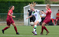 20180815 - Zulte , BELGIUM : OHL's Petra Baldewijns pictured in a duel with Zulte's Amber Bert (r) and Charlien Ver Eecke during a friendly pre season soccer match between the women teams of Zulte Waregem Dames and OHL Oud Heverlee Leuven Dames  , Wednesday 15 August 2018 . PHOTO DAVID CATRY | SPORTPIX.BE
