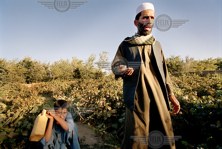 A grape farmer and his son tend to their crops in the Shomali Plains, north of Kabul. He talks of persecution under the Taliban, villages being burnt, women raped and crops destroyed. Life is now returning to normality.