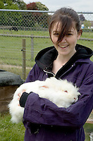 Holding a big white rabbit.  14-16yr olds on the School Link Project doing Animal Care at F.E.College.