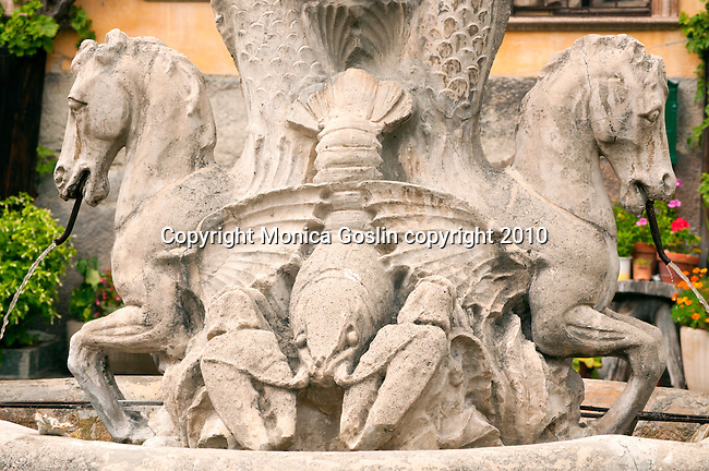 Fanciful fountain with sea horses and lobsters in Piazza Maggiore of Naggio, a small mountain town just above Menaggio on Lake Como, Italy