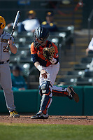Illinois Fighting Illini catcher Jacob Campbell (9) follows through on a throw to second base during the game against the West Virginia Mountaineers at TicketReturn.com Field at Pelicans Ballpark on February 23, 2020 in Myrtle Beach, South Carolina. The Fighting Illini defeated the Mountaineers 2-1.  (Brian Westerholt/Four Seam Images)