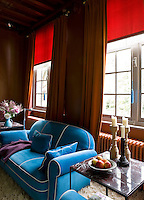 In the living room a comfortable velvet sofa, heavy curtains and shag-pile carpet create an atmosphere of old-style luxury and comfort