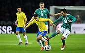 27th March 2018, Olympiastadion, Berlin, Germany; International Football Friendly, Germany versus Brazil; Philippe Coutinho (Brasil)  versus Ilkay Guendogan (Germany)