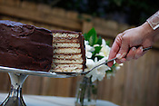 The Doberge Cake, a New Orleans tradition with seven layers of buttery rich cake, filled with chocolate custard and covered in two layers of chocolate icing, made by Carrie Boone, owner of Sweet Fingers Bakery.
