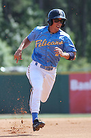Cole Miles #1 of the Myrtle Beach Pelicans rounding third base during a game against the Salem Red Sox on May 16, 2010 at BB&T Coastal Field in Myrtle Beach, SC.