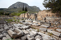 CORINTH, GREECE - APRIL 16 : A general view of the West Shops, on April 16, 2007 in Corinth, Greece. A row of shops, seen here in the early morning light, forms the west side of the forum. There is an an entrance to the Forum through the middle of the row. In front of the shops are many architectural fragments including columns and lintels. Corinth, founded in Neolithic times, was a major Ancient Greek city, until it was razed by the Romans in 146 BC. Rebuilt a century later it was destroyed by an earthquake in Byzantine times. (Photo by Manuel Cohen)