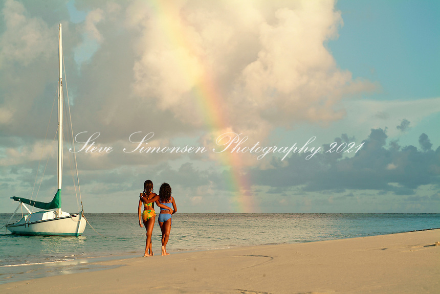 Girls walking on the beach with a rainbow<br /> Buck Island National Monument<br /> St. Croix<br /> U.S. Virgin Islands