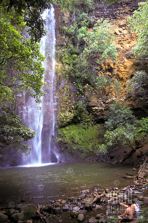 Couple admires Secret Falls, reached by kayaking up Wailua River to trailhead and then hiking to falls.