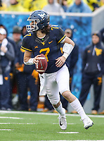 Morgantown, WV - November 18, 2017: West Virginia Mountaineers quarterback Will Grier (7) attempts a pass during game between Texas and WVU at  Mountaineer Field at Milan Puskar Stadium in Morgantown, WV.  (Photo by Elliott Brown/Media Images International)