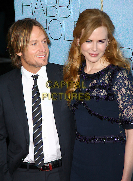 KEITH URBAN & NICOLE KIDMAN.Rabbit Hole the New York City Premiere held at the Paris Theater, - New York, NY, USA, 2nd December 2010..half length dress striped white shirt  suit tie married husband wife couple back purple beaded lace navy blue sequined sequin profile .CAP/ADM/PZ.©Paul Zimmerman/AdMedia/Capital Pictures.