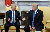 Prime Minister Benjamin Netanyahu of Israel speaks as United States President Donald J. Trump looks on in the Oval Office of the White House in Washington, DC, March 5, 2018.  <br /> Credit: Olivier Douliery / Pool via CNP