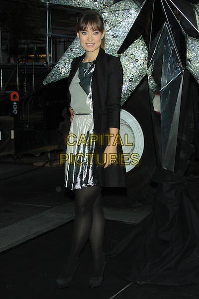 Olivia Wilde at the unveiling of the 2011 Rockefeller Center Christmas Tree Swarovski Star held at Rockefeller Plaza, New York, NY, USA..November 16th, 2011.full length black coat jacket white grey gray green dress silver .CAP/LNC/TOM.©TOM/LNC/Capital Pictures.