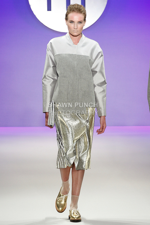 Model walks runway in an outfit by Sarah Conlon, during the FIT Future of Fashion 2014 Graduates' Collection fashion show, at the Fashion Institute of Technology on May 1, 2014.
