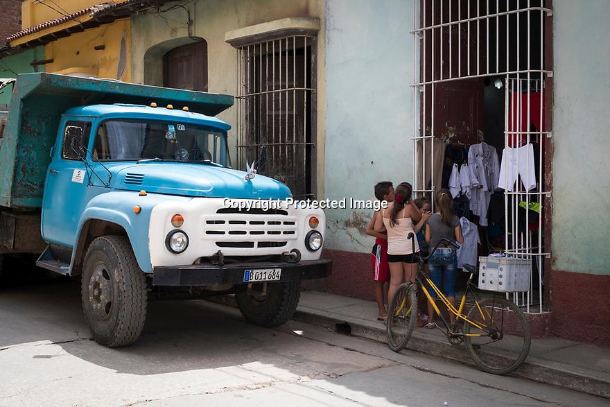27/07/18<br /> <br /> Clothes stall with old Russian Komatz truck, Trinidad, Cuba.<br /> <br /> All Rights Reserved, F Stop Press Ltd. (0)1335 344240 +44 (0)7765 242650  www.fstoppress.com rod@fstoppress.com