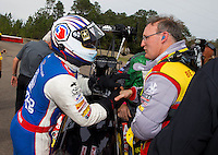 Mar 16, 2014; Gainesville, FL, USA; NHRA top fuel dragster driver and runner-up Antron Brown (left) congratulates Doug Kalitta after winning the Gatornationals at Gainesville Raceway Mandatory Credit: Mark J. Rebilas-USA TODAY Sports