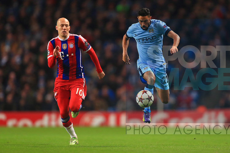 Arjen Robben of Munich chases Gael Clichy of Manchester City - Manchester City vs. Bayern Munich - UEFA Champion's League - Etihad Stadium - Manchester - 25/11/2014 Pic Philip Oldham/Sportimage