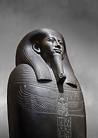 Ancient Egyptian greywacke sarcophagus of Vizier Gemenefherbak - late Period, 26th Dynasty (664-525BC). Egyptian Museum, Turin. Grey background<br /> <br /> Gemenefherbak was a vizier, minister, as indicated by a pendant picturing the goddess Maat hanging around his neck in the shadow of his beard. Despite the hardness of the greywacke stone the sarcophagus is made from, its makers have shown incredible skill creating a sarcophagus with intricate detail and a highly polished finish.