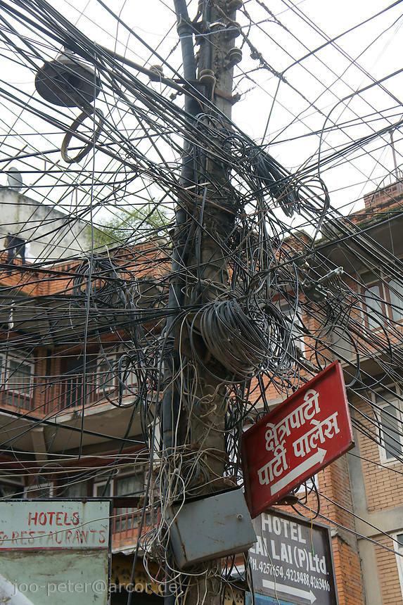 electricity lines in Kathmandu, , showing the typical chaotic structure of building catenary in Nepal.