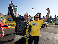 Nov 10, 2013; Pomona, CA, USA; NHRA pro stock driver Jeg Coughlin Jr celebrates with a crew member after clinching the 2013 pro stock championship during the Auto Club Finals at Auto Club Raceway at Pomona. Mandatory Credit: Mark J. Rebilas-