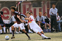 Mehdi Ballouchy (8) of the Colorado Rapids gets past Sinisa Ubiparipovic (8) of the New York Red Bulls. The Colorado Rapids defeated the New York Red Bulls 3-2 during a Major League Soccer match at Giants Stadium in East Rutherford, NJ, on May 30, 2009.