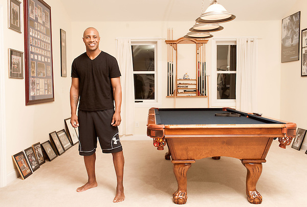 December 14, 2012. Durham, North Carolina.. Jay Williams in his home pool room, which is decorated with many photographs and posters from his basketball career which was ended by a 2003 motorcycle accident.. Jay Williams, a former point guard for the Chicago Bulls, is now a college basketball analyst for ESPN. Williams was a freshman all american at Duke University and helped lead the Blue Devils to a NCAA National Championship in 2001. . After being drafted in 2002 to the Chicago Bulls, he played one season in the NBA before his basketball career was ended by a serious motorcycle accident which nearly took his life.