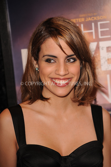 WWW.ACEPIXS.COM . . . . . ....December 2 2009, New York City....Actress Natalie Morales arriving at the 'The Lovely Bones' premiere at the Paris Theatre on December 2, 2009 in New York City.....Please byline: KRISTIN CALLAHAN - ACEPIXS.COM.. . . . . . ..Ace Pictures, Inc:  ..(212) 243-8787 or (646) 679 0430..e-mail: picturedesk@acepixs.com..web: http://www.acepixs.com