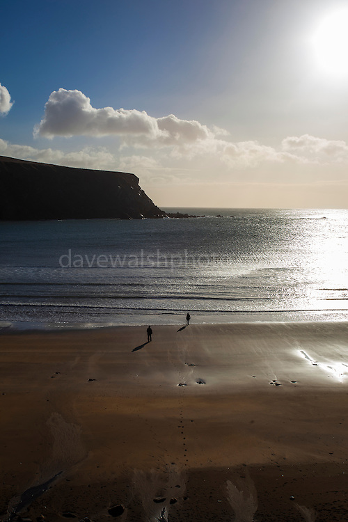 Two people on Silver Strand, Or Trabane Beach, near Malin Beg, Donegal, on Ireland's Wild Atlantic Way.