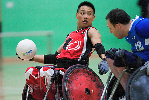 15 AUG 2011 - LEEDS, GBR - Canada's Ian Chan tries to pass  during the wheelchair rugby exhibition match against Great Britain .(PHOTO (C) NIGEL FARROW)