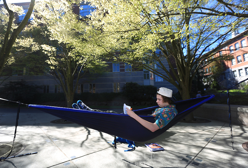 March 30th, 2016- Shawn Horton, of Bend, OR and a Freshman at Seattle University takes an afternoon study session in his hammock that he set up in Seattle U's Quad area.